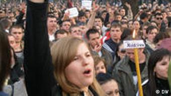 Young female protester in front of a crowd
