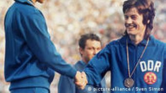 East German athlete is congratulated after winning a medal