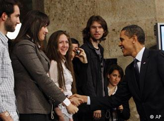 Obama shakes hands with members of the public
