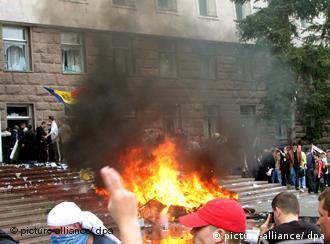 Protestors in Moldova burn furniture outside of parliament