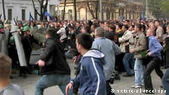 Moldovan demonstrators clash with riot police during an anti-communist rally