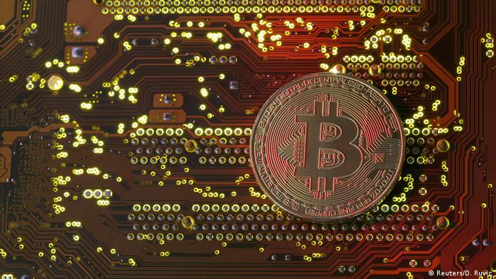 Bitcoin on a motherboard (Reuters/D. Ruvic)