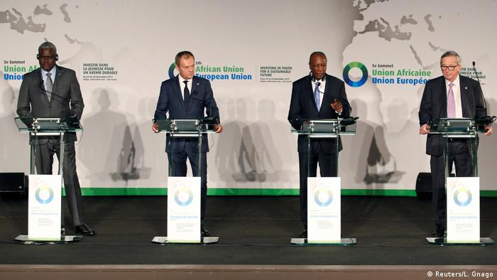 Alpha Conde, Donald Tusk, Moussa Faki Mahamat and Jean-Claude Juncker address a news conference