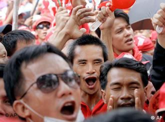 Shouting protesters in Thailand wearing the color red