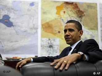 Maps of Iraq can be seen on the wall as President Barack Obama meets with Gen. Ray Odierno at Camp Victory in Baghdad, Iraq, Tuesday, April 7, 2009.