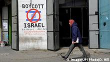 A Palestinian walks by graffiti reading Boycott Israel at the entrance to the Beit Jibrin Refugee Camp in Bethlehem, West Bank, February 11, 2015. A high level national Palestinian committee announced it has instructed stores across the West Bank to ban products from six major Israeli companies, which are: Tnuva, the Strauss Group, Osem, Elite Prigate and Jafora-Tabori. The ban is meant to countermeasure Israel s decision to withhold Palestinian tax revenue it collects on behalf of the Palestinian Authority. West Bank grocers must stop selling Israeli products within two weeks from today. PUBLICATIONxINxGERxSUIxAUTxHUNxONLY JER2015021101 DEBBIExHILL a PALESTINIAN Walks by Graffiti Reading Boycott Israel AT The Entrance to The Beit Refugee Camp in Bethlehem WEST Bank February 11 2015 a High Level National PALESTINIAN Committee announced IT has instructed Stores across The WEST Bank to Ban Products from Six Major Israeli Companies Which are The Strauss Group Elite and Tabori The Ban IS meant to countermeasure Israel S Decision to withhold PALESTINIAN Tax Revenue IT Collect ON behalf of The PALESTINIAN Authority WEST Bank Haekeln Grocers must Stop Selling Israeli Products Within Two Weeks from Today PUBLICATIONxINxGERxSUIxAUTxHUNxONLY JER2015021101 DEBBIExHILL