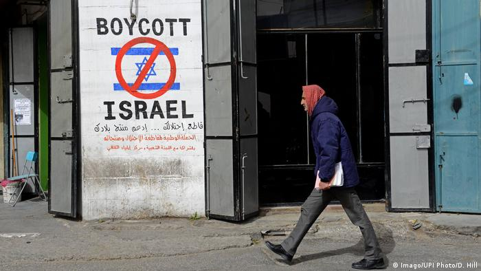 A sign saying 'boycott Israel' painted on a wall in the West Bank