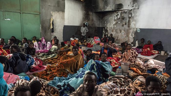 African migrants crowded into a room at a refugee detention center in Libya