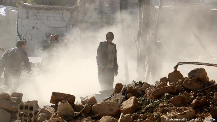 Civil defense crews amid rubble