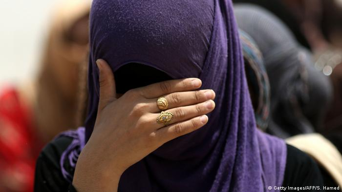 A displaced Iraqi woman who family members are accused of being IS militants (Getty Images/AFP/S. Hamed)