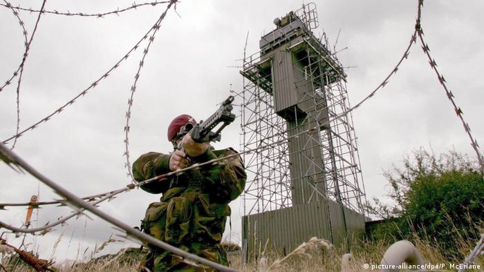 A British Army Paratrooper looks through his rifle sight at a watchtower post in Northern Ireland
