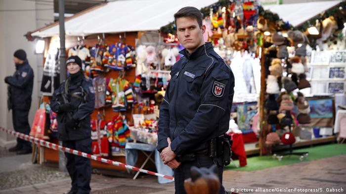 Police officers standing at a Christmas market