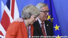 Jean-Claude Juncker und Theresa May