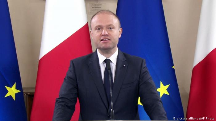 Malta's Prime Minister Joseph Muscat gives a statement to announce the arrest of eight suspects in the Oct. 16 murder of investigative journalist Daphne Caruana Galizia