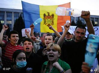 Protestors shout slogans at the parliament building in Chisinau, Moldova, Wednesday, April 8, 2009