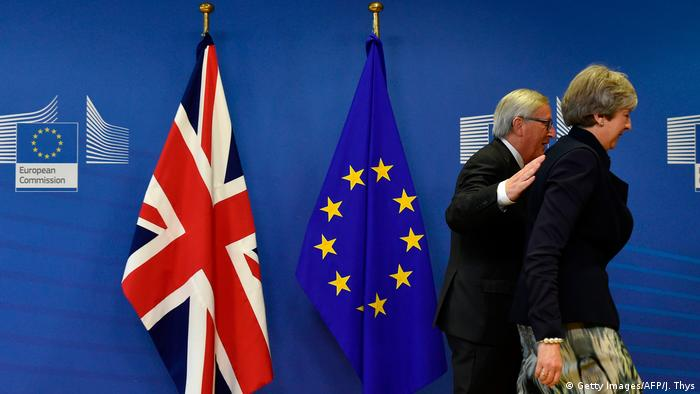 Jean-Claude Juncker and Theresa May arrive for a Brexit meeting in Brussels