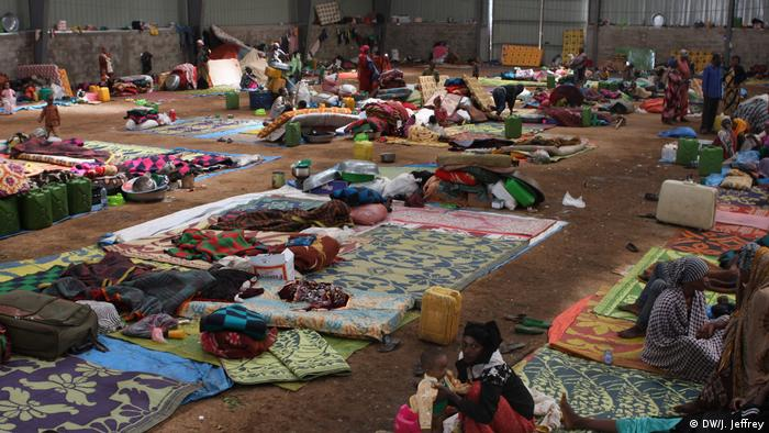 Displaced Oromo sheltering in an industrial warehouse