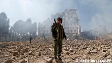 Huthi rebel fighters inspect the damage after a reported air strike carried out by the Saudi-led coalition targeted the presidential palace in the Yemeni capital Sanaa on December 5, 2017. Saudi-led warplanes pounded the rebel-held capital before dawn after the rebels killed former president Ali Abdullah Saleh as he fled the city following the collapse of their uneasy alliance, residents said. / AFP PHOTO (Photo credit should read /AFP/Getty Images)