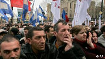 Supporters of the Georgian opposition take part in a rally calling on Georgian President Mikhail Saakashvili to step down, in front of the parliament in Tbilisi, Georgia, Thursday, April 9, 2009.