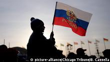 A boy waves a Russian flag in Olympic Park at the Winter Olympics in Sochi, Russia, on Wednesday, Feb. 19, 2014. The International Olympic Committee has banned Russia from competing in the 2018 Winter Olympics in Pyeongchang, South Korea. (Brian Cassella/Chicago Tribune/TNS) Photo via Newscom picture alliance |