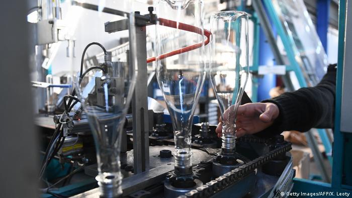 Photo: An employee making bottles from bioplastics