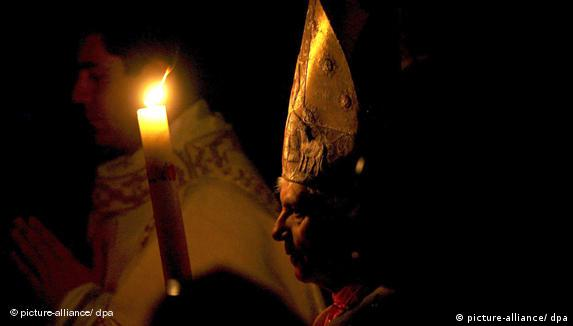 Pope Benedict XVI holds a candle during the Easter vigil mass in