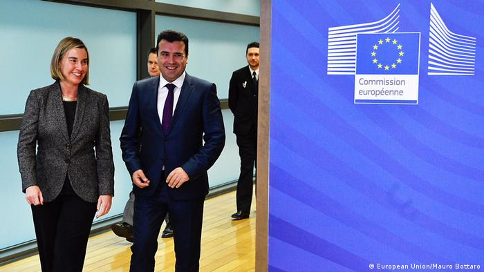 Macedonian president Zoran Zaev and EU Foreign Minister Federica Mogherini walk down a hallway at the European Commission