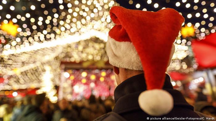 A man in a Santa hat at a German Christmas market