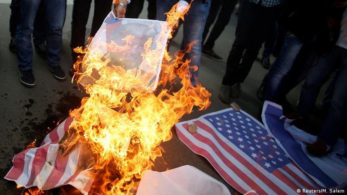 A picture of a US flag on fire in the Gaza Strip