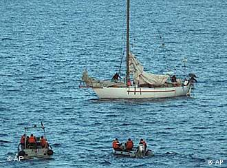 This undated photo provided Friday, April 10, 2009 by the French navy shows negotiators and members of the French navy on boats near the French sailboat Tanit, off the coast of Somalia.