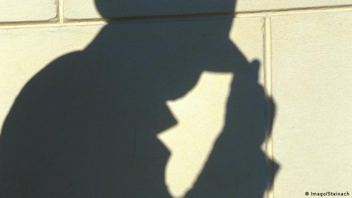 Shadow of a man with a hat