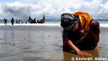 Rohingya refugee kneels at beach (Reuters/D. Siddiqui)