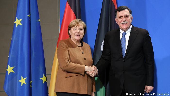Berlin Merkel and Fayez al-Sarraj