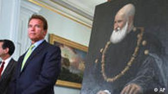 Arnold Schwarzenegger stands with a Renaissance painting