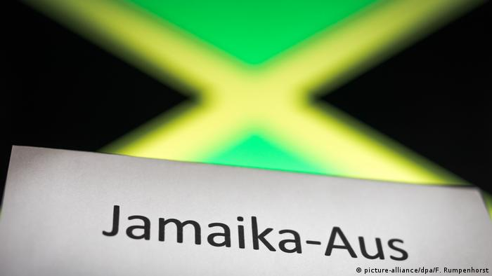 The word Jamaika-Aus backdropped by a Jamaica flag (picture-alliance/dpa/F. Rumpenhorst)