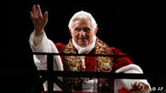 Pope Benedict XVI greets faithful after celebrating the Via Crucis (Way of the Cross) torchlight procession on Good Friday in front of the Colosseum in Rome, Friday, April 10, 2009. The evening Via Crucis procession at the ancient Colosseum amphitheater is a Rome tradition that draws a large crowd of faithful, including many of the pilgrims who flock to the Italian capital for Holy Week ceremonies before Easter Sunday. (AP Photo/Riccardo De Luca)