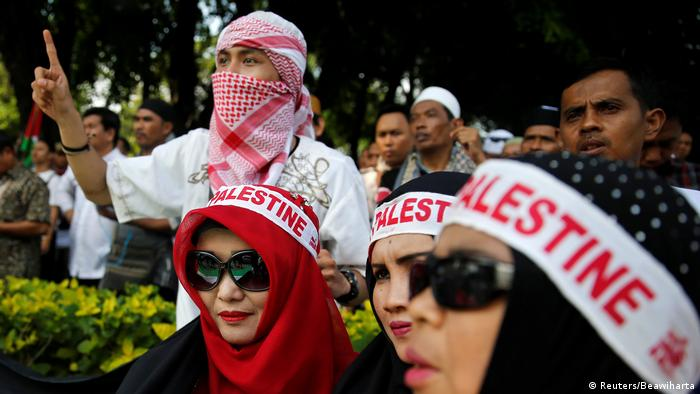 Protestors wear Palestine banners in Jakarta. In Indonesia, the world's most populous Muslim nation, more than 300 protesters shouted Go to hell Israel! and called on Trump to stop blind support for the Jewish state. (Reuters/Beawiharta)