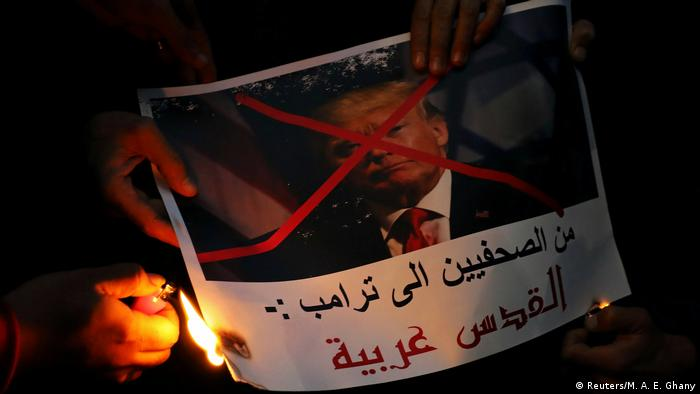 Protesters in Egypt burn a picture of US President Donald Trump with his face crossed out during a protest in front of the Syndicate of Journalists in Cairo. The picture reads, Journalists are telling you Trump, Jerusalem is Arab. Hundreds of protesters also gathered in Al-Azhar mosque and outside in its courtyard. (Reuters/M. A. E. Ghany)