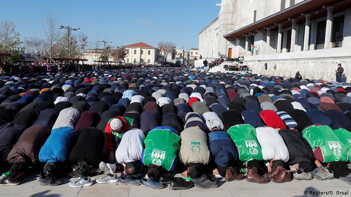 Demonstrators in Turkey hold a mass prayer to protest Trump's Jerusalem gambit.