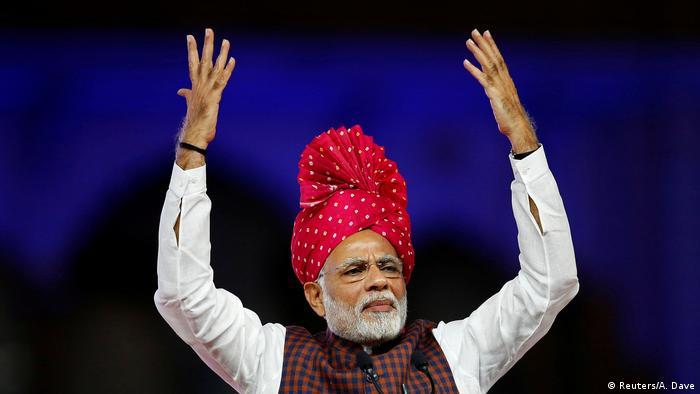 Indian Prime Minister Narendra Modi gesturing on stage