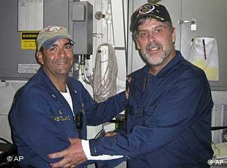 Maersk-Alabama Capt. Richard Phillips, right, and Cmdr. Frank Castellano of the USS Bainbridge