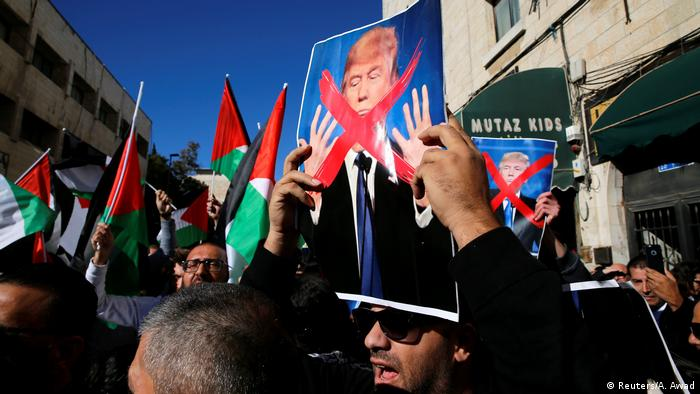 Palestinians hold anti-Trump posters in E. Jerusalem protest
