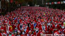 Thousands of people dressed as Santa Claus take part in a race in Madrid, Spain with an aim of raising money for cancer care.