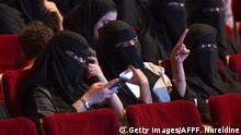 20.10.2017 Saudi women attend the Short Film Competition 2 festival on October 20, 2017, at King Fahad Culture Center in Riyadh. The rare movie night this week in Riyadh was a precursor to what is expected to be a formal lifting of the kingdom's ban on cinemas, long vilified as vulgar and sinful by religious hardliners. / AFP PHOTO / FAYEZ NURELDINE (Photo credit should read FAYEZ NURELDINE/AFP/Getty Images)