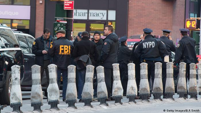 New York Police and FBI officials converge on the bomb scene at the Port Authority Bus Terminal