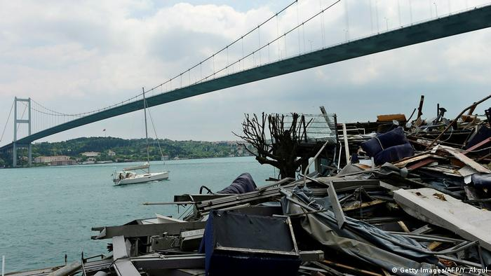 Debris from the Reina night club in the shadow of the Bosphorus Bridge; officials ordered the club be demolished.