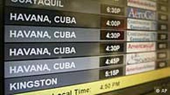 Flights arriving from Havana are shown on a monitor at Miami International Airport Monday, April 13, 2009