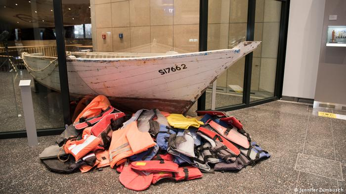 a boat and life jackets shown in a museum (Jennifer Zumbusch)