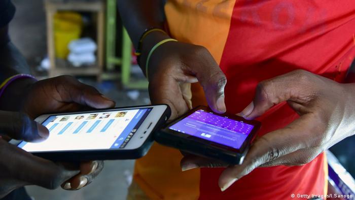 People in Ivory Coast using smartphones