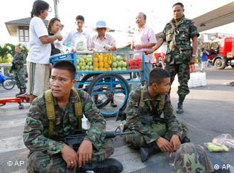 Thai soldiers take a rest as protesters disperse